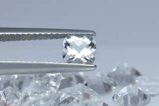 WHT01817M - White Topaz 5x5mm Cushion, 0.63 carats