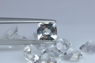 WHT01821M - White Topaz 6x6mm Cushion, 1.06 carats